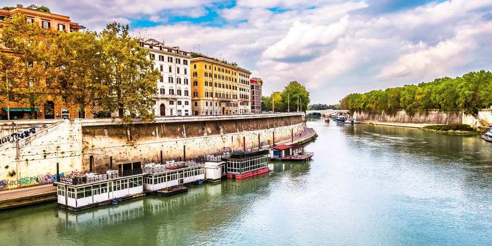 Boats on Tiber river in Rome